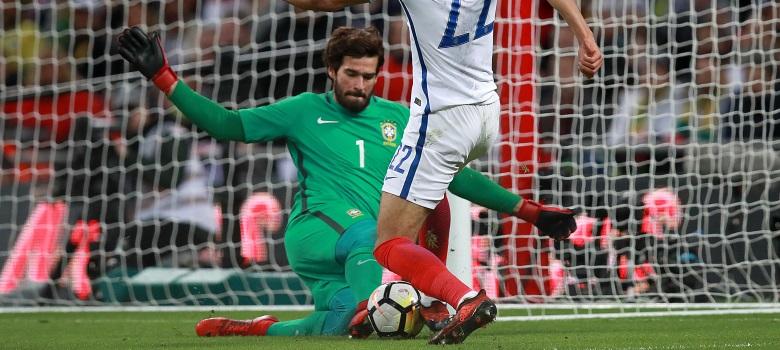 Brazil goalkeeper Alisson Becker in action against England
