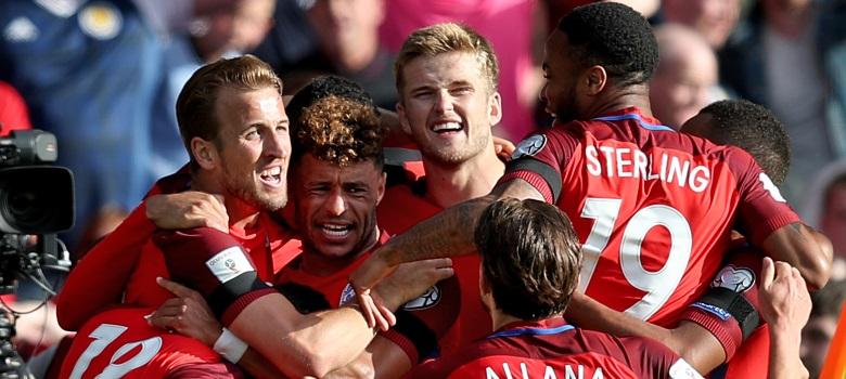 England players celebrate scoring a goal