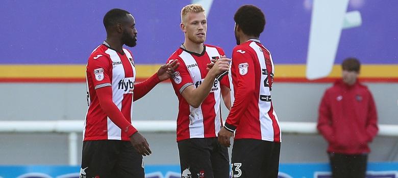 Jayden Stockley celebrates scoring for Exeter
