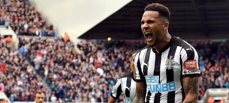 Lascelles passionately celebrates his goal for Newcastle.